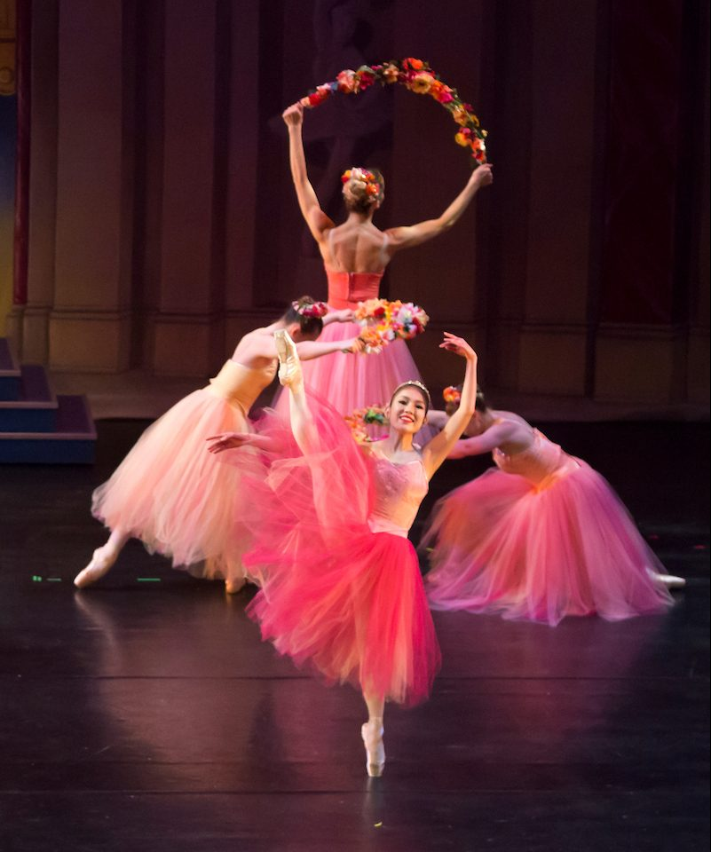 Four dancers in pink with flowers
