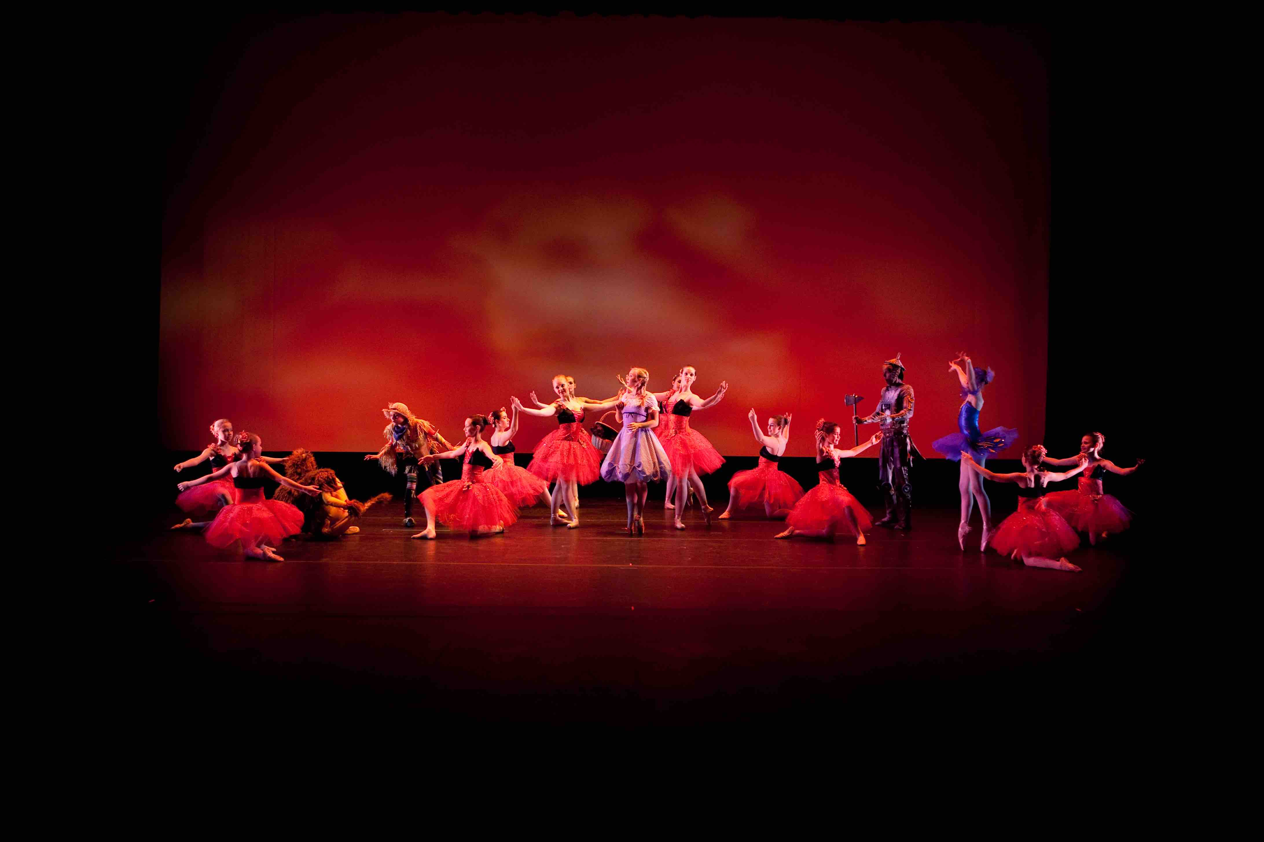 Dancers in red surrounding Dorthy from The Wizard of Oz Ballet