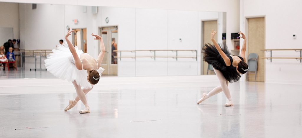 Two dancers rehearsing for a performance